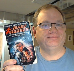 Posing with my 31 year old beat up copy of Blade Runner in paperback.