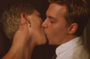 Jillian (Charlize Theron) and Spencer (Johnny Depp) share a kiss.