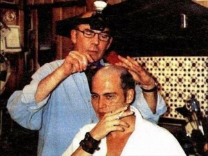 Hunter S. Thopmson shaving Johnny Depp's head. - Source Unknown.