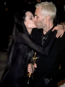 Angelina and James share a kiss.